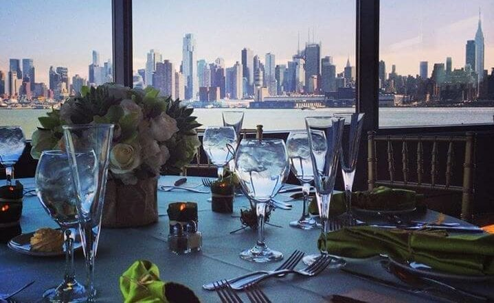 table set with dinnerware against a backdrop of the New York City skyline