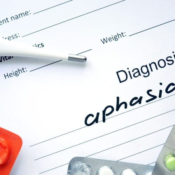 Diagnosis aphasia and tablets. Medicine concept.