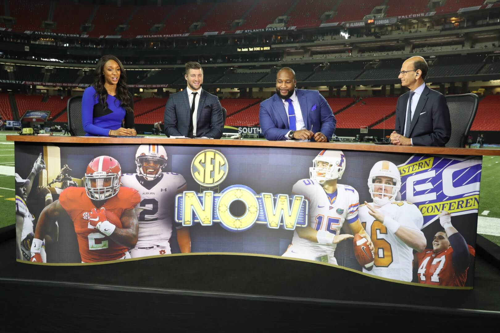 Maria Taylor, Tim Tebow, Marcus Spears and Paul Finebaum on the set of SEC Now during the 2016 SEC Championship