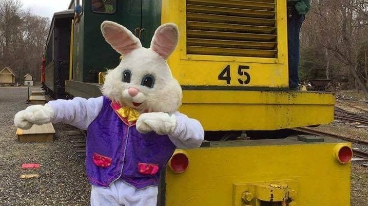 Easter Bunny standing in front of a train engine
