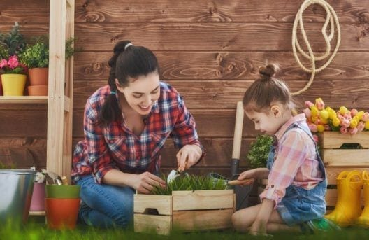 woman gardening with child