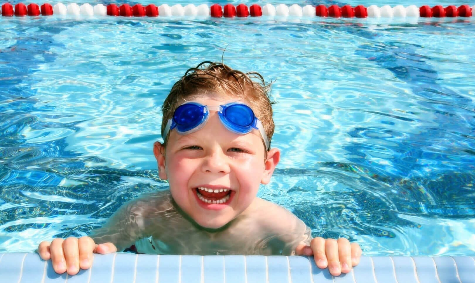 child smiling in water