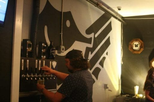 pouring beer from tap