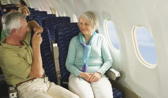 older couple on airplane