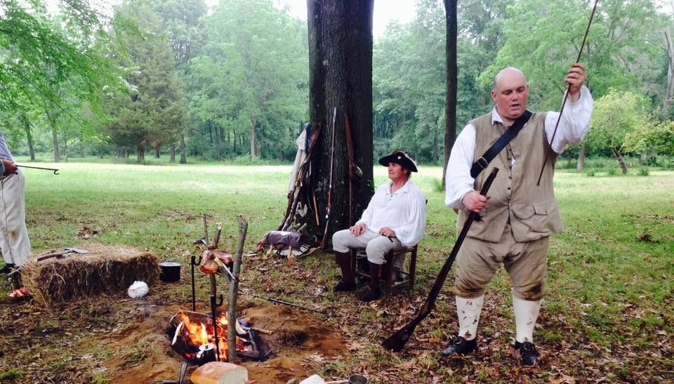 shot of reenactors with tools in a wooded area