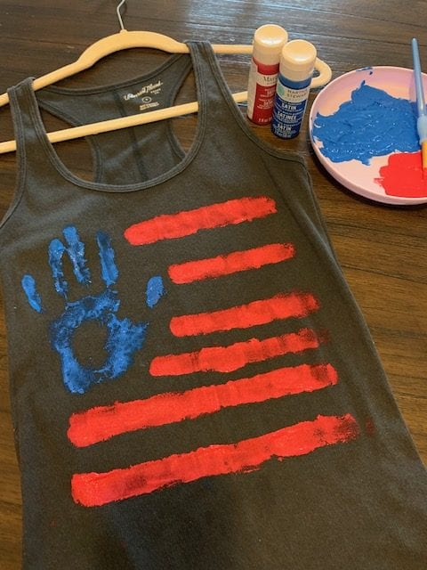 Painting American Flag on T-shirt for Independence Day