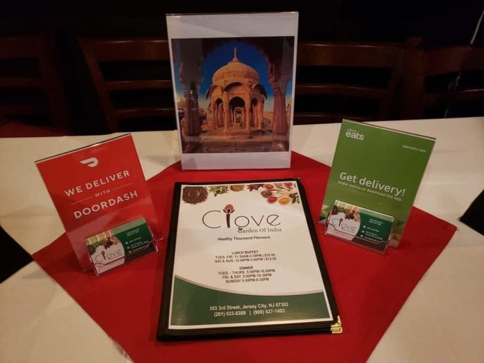 Menu and Place Setting at Clove Garden of India